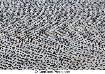 Black stone floor tile in sunny day
