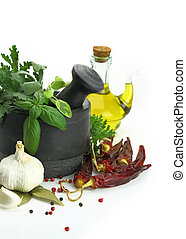Black stone mortar and pestle with fresh herbs