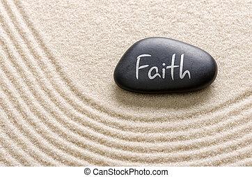 Black stone with the inscription Faith