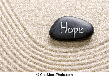 Black stone with the inscription Hope
