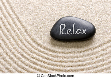 Black stone with the inscription Relax