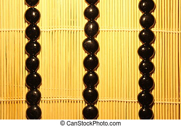 black stones on a wooden background