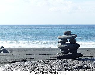 Black stones on the beach