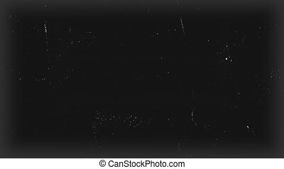Black surface of the old film with scratches
