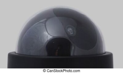 Black surveillance camera rotates, red led blink, close-up...