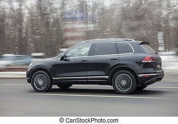 SUV driving on the highway in winter