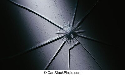 Black table lie shards of glass - Glass table there are...