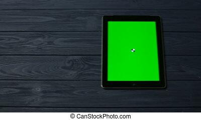 Black Tablet Pc on Dark Blue Table - Black Tablet Pc on Dark...