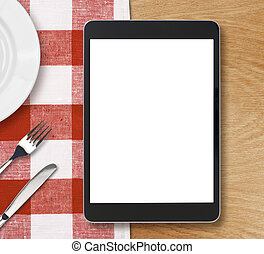 black tablet pc on dinner table with blank screen