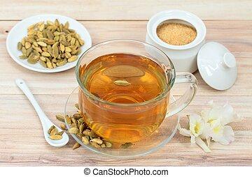 Black tea and cardamom seeds - Used for unique taste of tea ...