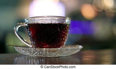 Black tea brewed with hot water in a glass cup