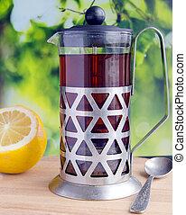 Black tea in a glass teapot