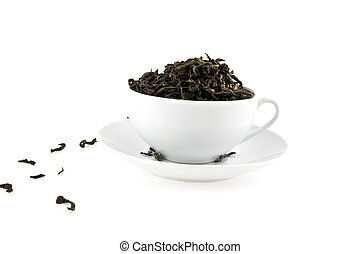 black tea leaves in a cup, isolated on white