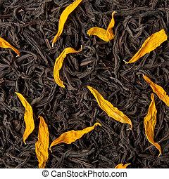Black tea loose dried tea leaves and sunflower petals
