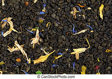 Black tea mixed with herbs and dry fruits. Calendula, sunflower, cornflower, rosehip berries. texture.