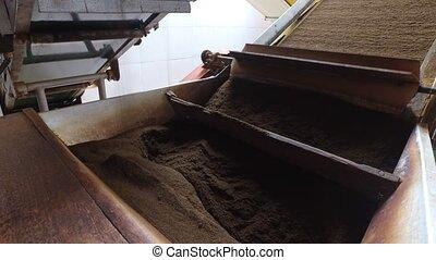black tea moving on machine conveyor at factory