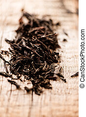 Black tea on wooden background