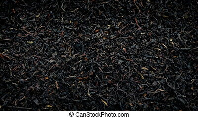 Black Tea Rotates Closeup - Closeup shot of dried black tea...