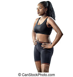 Black teen fitness girl looking aside isolated.