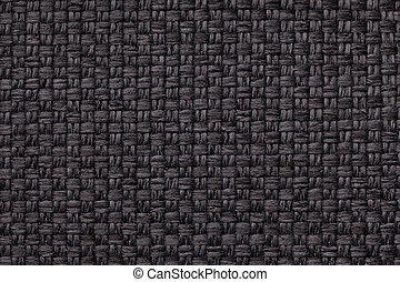 Black textile background with checkered pattern, closeup. Structure of the fabric macro.