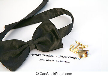 Black tie event - Bow tie, gold cufflinks and an invitation ...