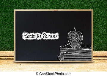 Black to school concept. Black chalkboard texture with text and apple on stacked book chalk style with green leave background.advertising, sale. education concept.