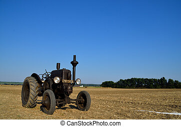 black tractor on a field