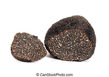 truffles - black truffles (tuber melanosporum) in front of a...