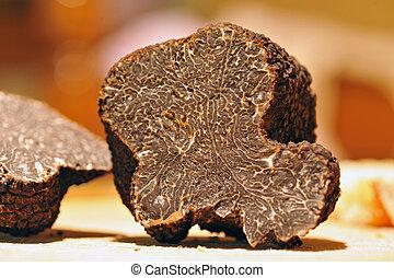 truffles - black truffles (tuber melanosporum) on a table