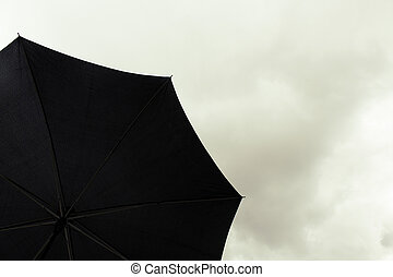 Black Umbrella In Cloudy Sky