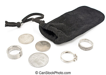 Black velvet sack with silver rings and coins on white