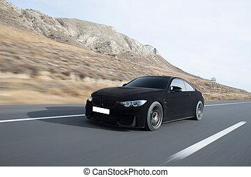 Black velvet sport sedan on the highway