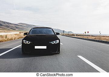Black velvet sport sedan on the road