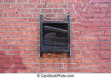 Black Vent on Red Brick Wall