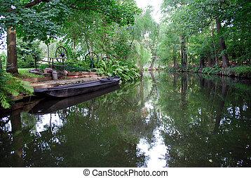 "black vintage boats in a creek of \""spreewald\"" area,..."