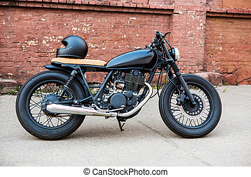 Black vintage custom motorcycle cafe racer