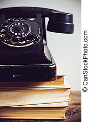 vintage rotary phone - Black vintage rotary phone and books...
