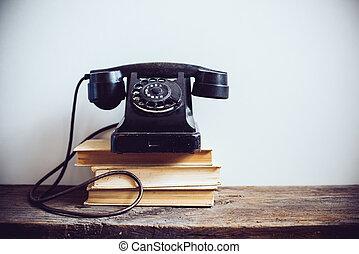 vintage rotary phone - Black vintage rotary phone and books...