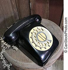 black vintage telephone on wood