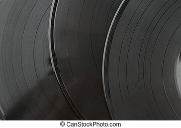 Black vinyl records background.