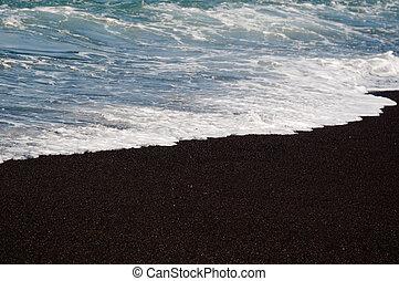 Black volcanic sand beach - Black volcanic sand on the beach...