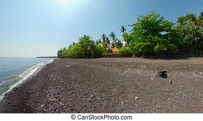 Black volcanic sand beach - little planet view tropical...