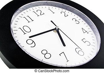 Black wall clock on white