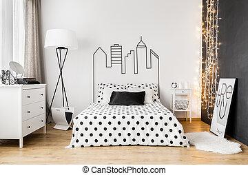 Black wall in bright bedroom interior