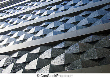 Black wall of a relief building in the city.