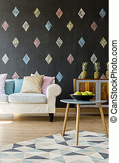 Black wall with coloured diamonds and pineapples