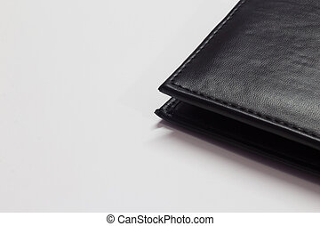 Black wallet isolated on white background with space for text
