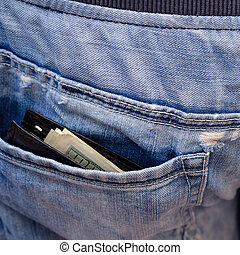 Black wallet with money, sticking out of the back pocket of the jeans. Nonchalance concept. For instagram format. Square.