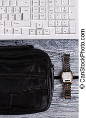 Black wallet with watch.