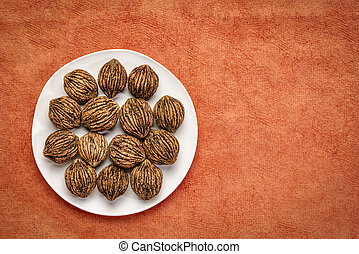 black walnuts on a white plate